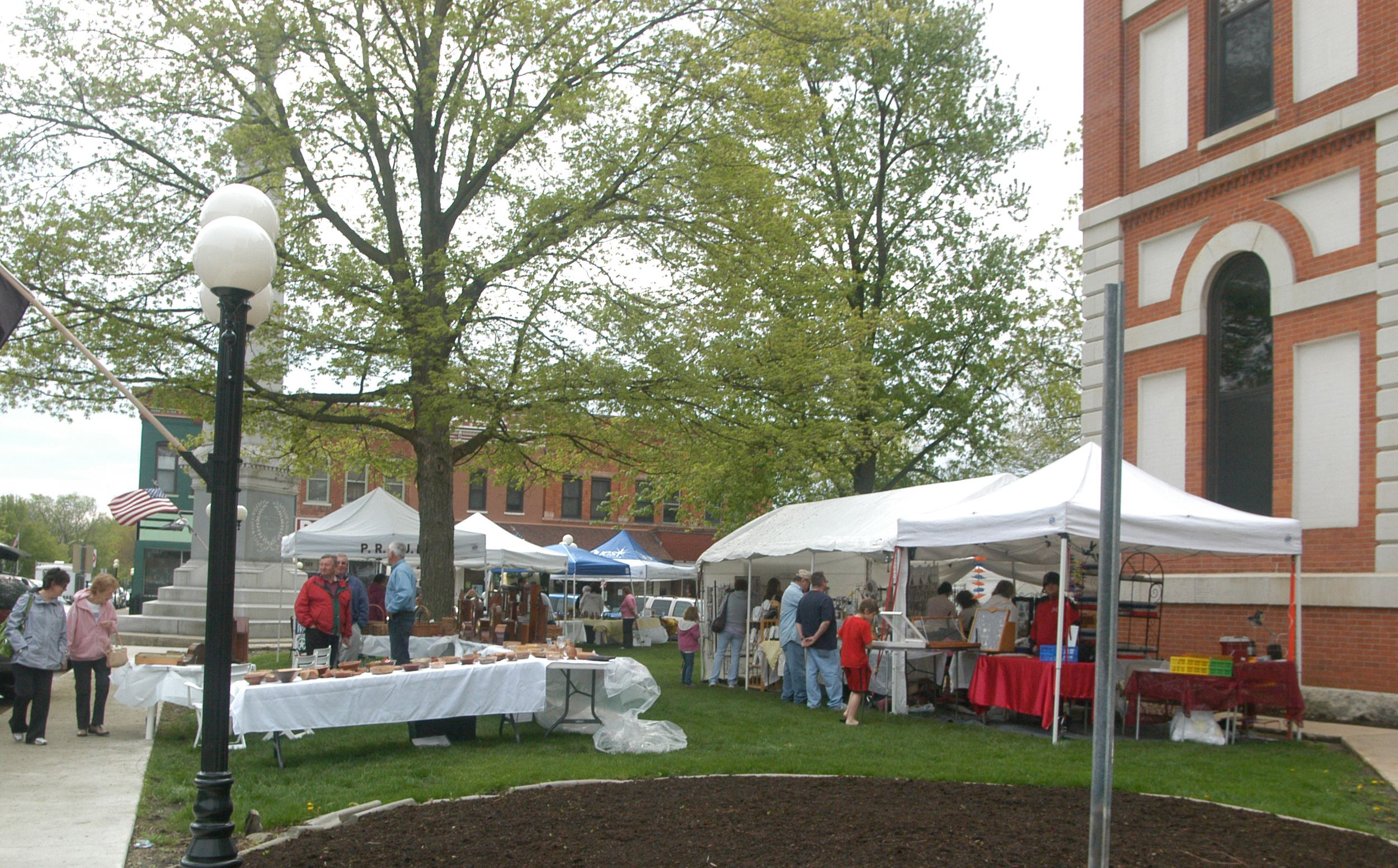 People stroll through Pontiac and browse booths of food and homemade wares.