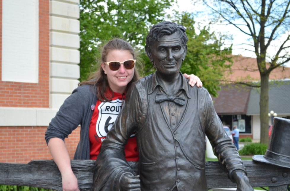Woman posing with Lincoln statue