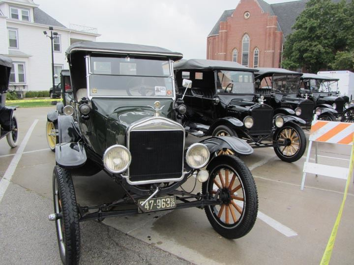 Model T and Model A cars in parking lot
