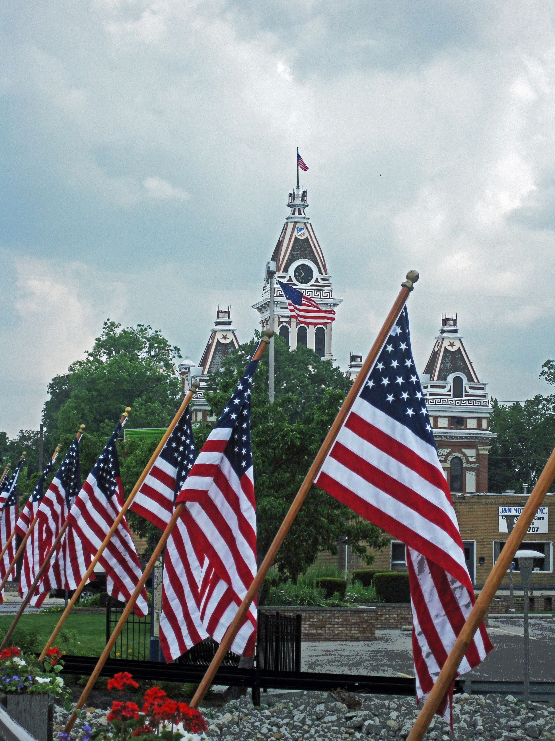 Courthouse in distance, American Flags in foreground