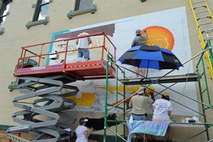 Walldogs Work on Mural