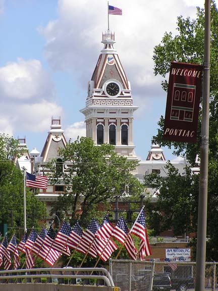 Courthouse with American Flags in Foreground