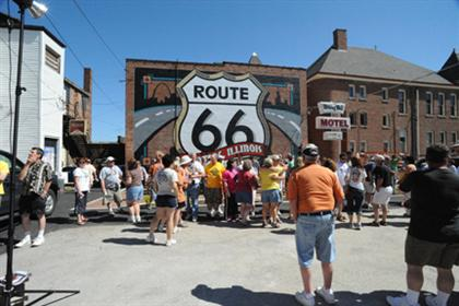 Folks Gather at Route 66 Shield Mural