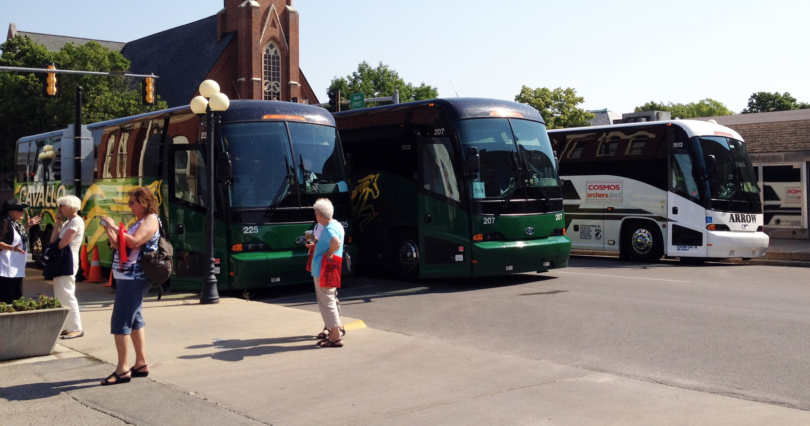 Three Coach Buses on Main Street