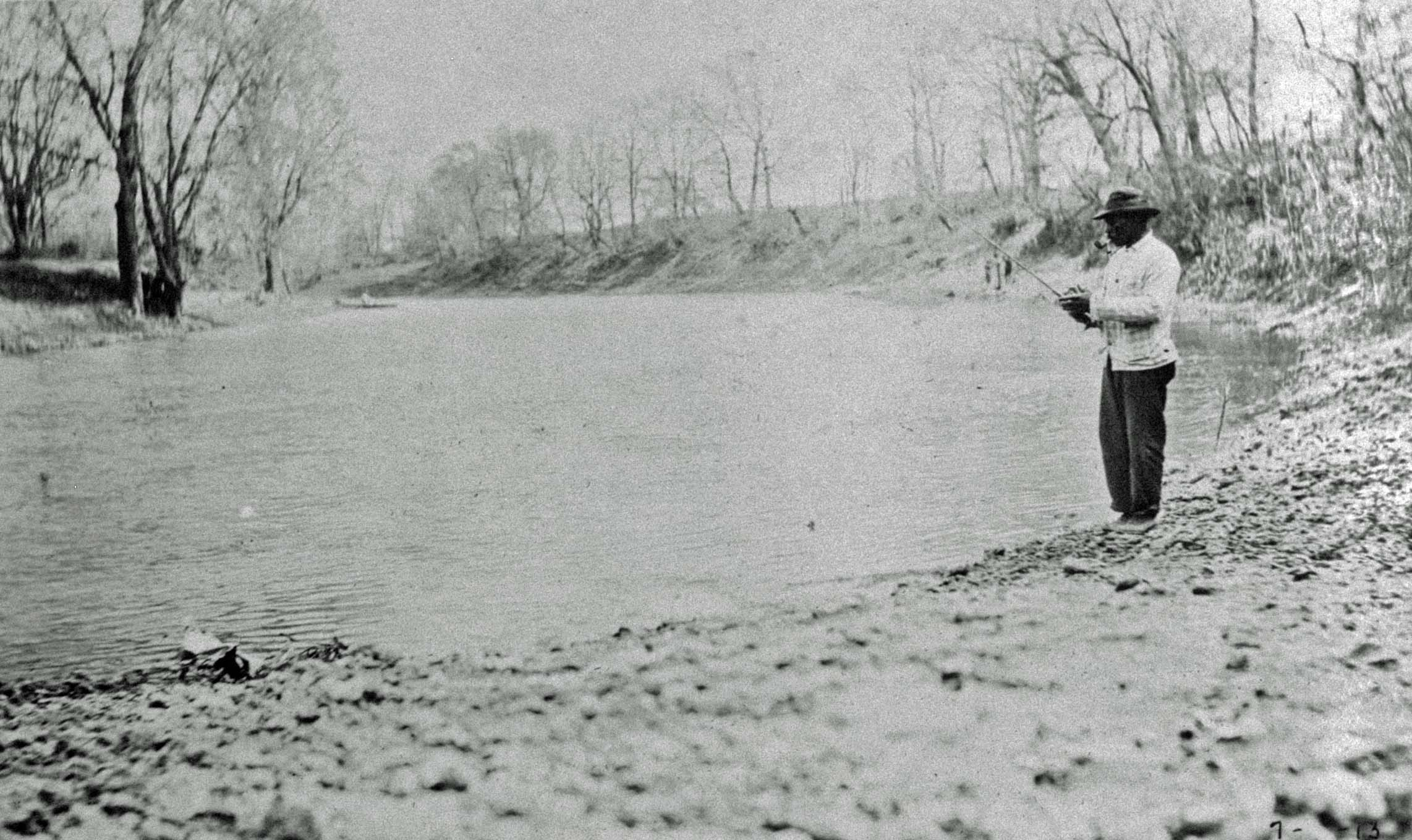 Man fishing by the Vermllion River