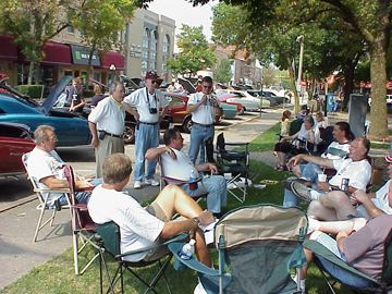 A group of people relaxing during Pontiacs in Pontiac in 2004.