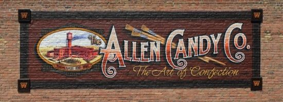 The Allen Candy Company logo painted as a mural on Main Street.